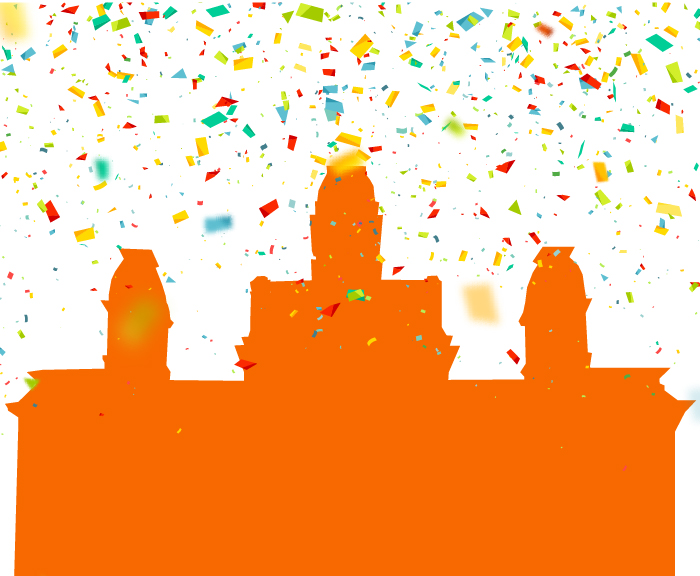 Confetti rains over a orange silhouette of the hall of languages