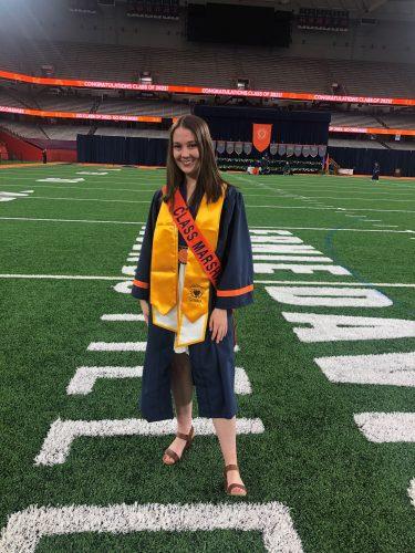 Paige Koss in her graduation regalia