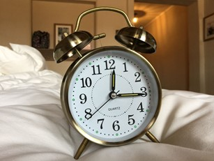 A classic brass alarm clock.