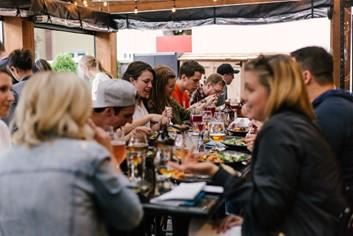 A large group of friends having lunch al fresco.