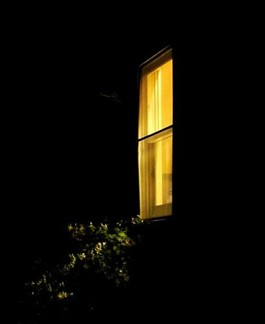 Light from a window breaks up the night outside.