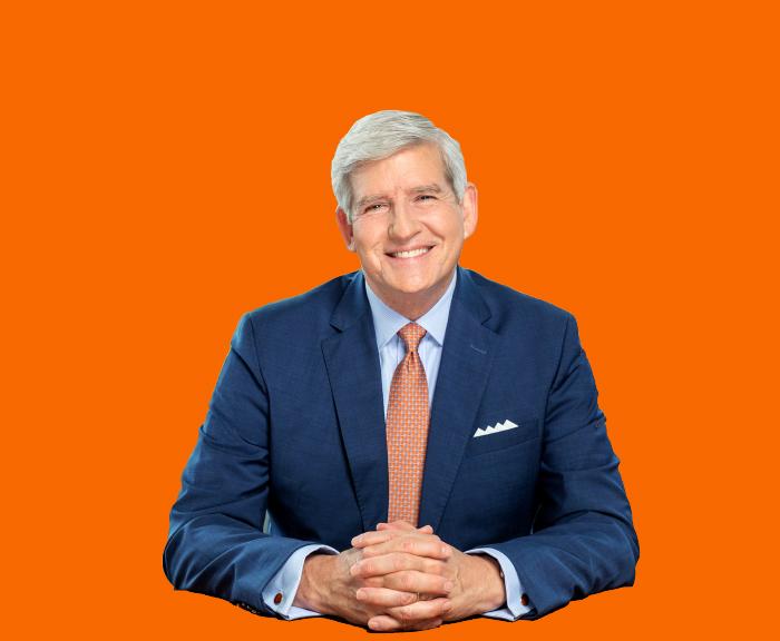 Allen Groves on an Orange background