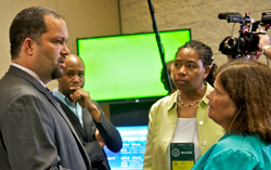 NAACP CEO Benjamin Jealous, left, speaks with Janis McDonald, Paula Johnson and Scott McDowell from the Cold Case Justice Initiative during the NAACP convention in Orlando, Fla.