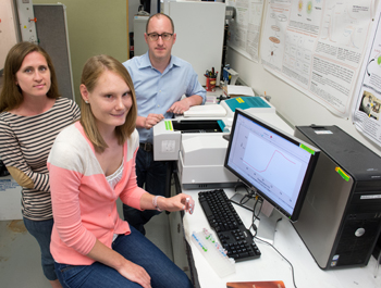 Associate Professor Mathew M. Maye supervises graduate students Colleen Alexander, left, and Kristen Hamner  in his chemistry lab.