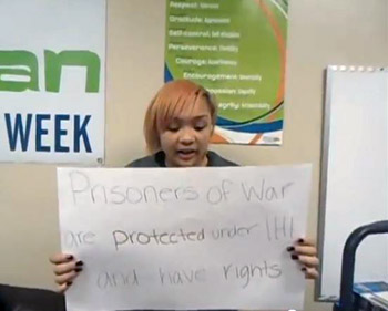 A Southside Academy Charter School student discusses laws involving prisoners of war for a video as part of the American Red Cross IHL Action Campaign. SU students Mallory Lang '13 and Adyna Lungu '13 worked with the group of students to create the video.