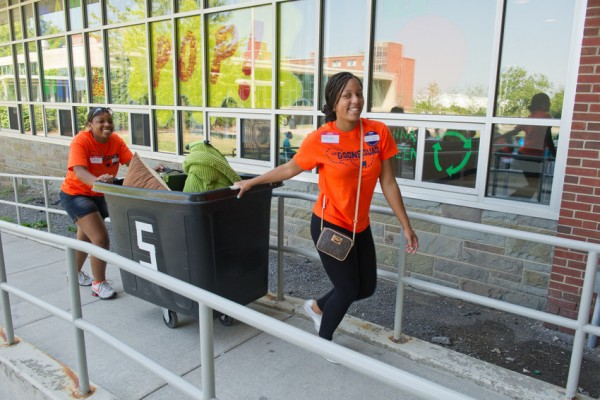 Two members of the Goon Squad help during the the 2012 Syracuse Welcome. This year's Syracuse Welcome will take place Aug. 21 and 22.