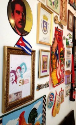 Balcon Criollo is a gallery-wide installation of meaningful artifacts showcasing the  community's most cherished memories, their countries of origin and family histories.