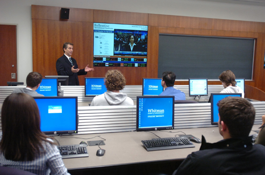 Whitman Professor of Finance and Director of the Ballentine Investment Institute Fernando Diz teaches a class in a high-tech classroom.