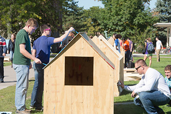 "Students complete the finishing touches on one of the many ""shacks"" put together on the Quad Wednesday for Shack-A-Thon, hosted by the SU and SUNY ESF Habitat for Humanity chapter."