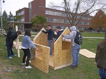 Students build their shack during a previous Shack-a-thon on the Quad.