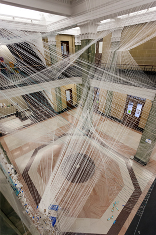 Composed of more than 70,000 linear feet of white string suspended across the central space of the atrium, the Pan Am Flight 103 installation depicts transition into the afterlife, remembrance and the ability of architecture to act as an agent of change through collaboration and physical expression. Photo by Jamie Young.