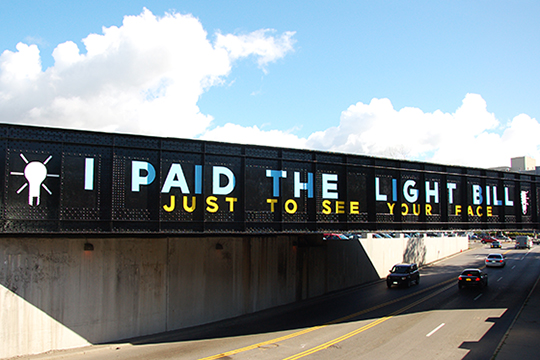 """The """"A Love Letter to Syracuse"""" mural is located on the train trestles over West and West Fayette streets in downtown Syracuse."""