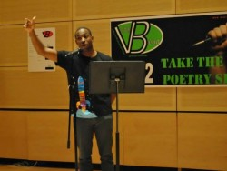 "Ousman Diallo competes at last year's ""Take the Mic"" poetry slam."