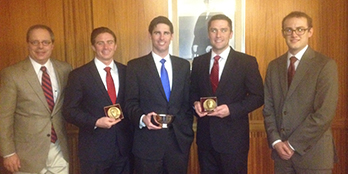 Syracuse Law's National Appellate Team poses with their coach, Professor Richard Risman.