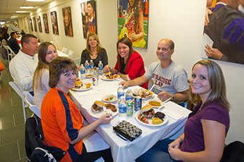 After attending lectures and watching trial teams, law student families enjoy lunch during Family Day.