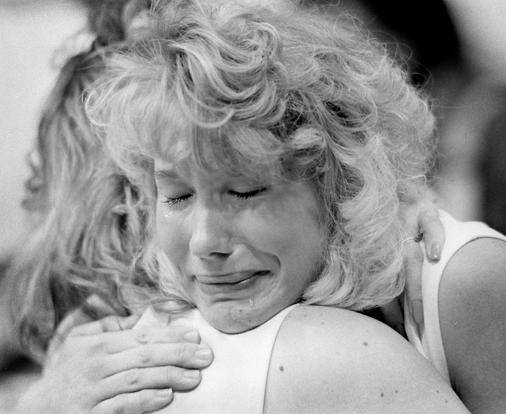 Catherine Crossland hugs a friend at an SU basketball game on Dec. 21, 1989, hours after learning about the explosion of Pan Am 103 and the deaths of 35 SU students aboard.