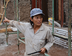 Yutaka Sho works at the site of the prototype house in Masoro, Rwanda.