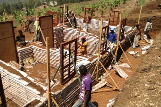 Earthbags are used to build a house in Masoro, Rwanda. GA Collective aims to build 50 houses in partnership with Dushigirikane.