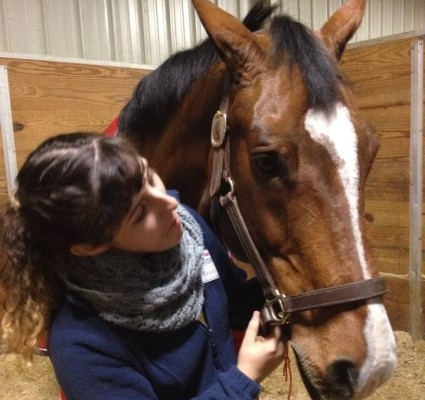 "Emily Dengler, a member of the SU English Equestrian Club, works with ""Sailing"" during her time assisting with the Emerging Athletes Program in conjunction with the Horsemanship Quiz Challenge in November."