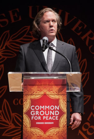 Gregg Lambert at the podium during the Common Ground for Peace event in 2012