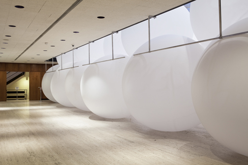 "In the exhibition ""Acadia,"" 20,000 cubic feet of air was compressed at Acadia National Park in Maine and moved to inflate more than 60, 10' meteorological balloons. As the balloons deflate or burst the atmosphere of the museum is changed."