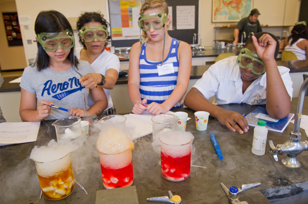 The national education landscape is shifting for teachers—and new teachers being prepared in the School of Education—as the Common Core standards are put in place. In this photo, Nottingham High School students perform experiments at a School of Education science summer camp.
