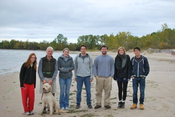 Professor John Western, second from left, and honors students get to know each other on a weekend at Lake Ontario.