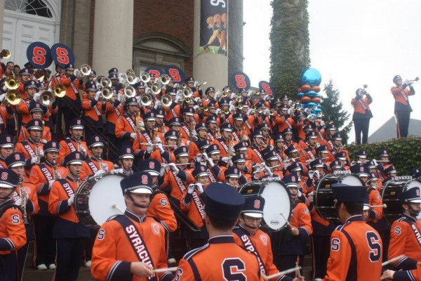 The SU Marching Band will perform on the field before Super Bowl xxx.