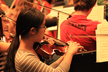 A young violinist plays with the Syracuse Youth Orchestra.