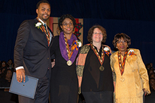 This year's Unsung Heroes are honored during the Martin Luther King Jr. Celebration at the Carrier Dome on Sunday, Jan. 19. They are, from left: Joseph, Deborah Person, Georgia Popoff and Dorothy Russell.