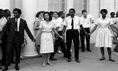Diane Nash, center, leads a group of students in a protest in front of the Nashville, Tenn., police station in 1961.  The students were protesting police brutality against protesters at lunch counters.  (Photo by the Tennessean).