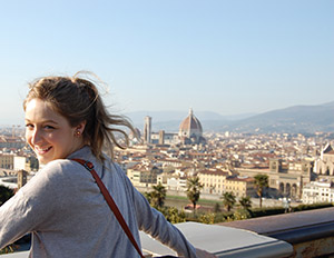 The Florentine skyline stretches out behind SU Florence student Ali Whitney.