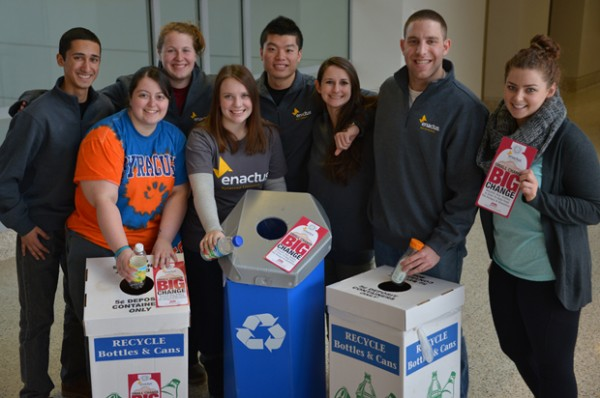 Enactus members hope new stickers will remind students that spare change from bottles and cans can make a big impact on the homeless and hungry.