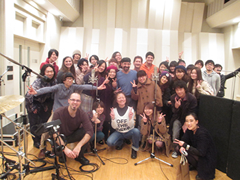 Grupo Pagán and two music industry students from SU  pose with students at the  Senzoku Gakuen in January.. Those students are now in Syracuse.