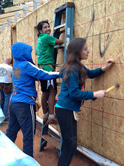 Habitat for Humanity volunteers work on a house during last year's spring break.