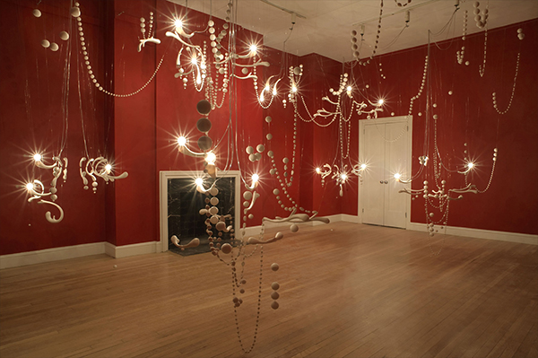 Jeanne Quinn, Everything Is Not As It Seems, (as installed at the Jane Hartsook Gallery, NYC, 2009). Porcelain, wire, paint, electrical hardware, 24'W x 17'D x 17'H (Photo by Cathy Carver)
