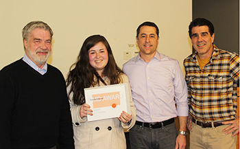 Jordan Firkey '16, second from left, receives the TracyLocke Scholarship from (l-r): Professor Robert Cooney, communications design program coordinator; Jay Verna '95, client director, TracyLocke; and Frank Oggeri, group creative director/creative recruiter, TracyLocke.