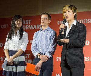 Tiffany Pau '17, Jonathan Anthony '17 and Ruo Piao Chen '17 present their team's idea during the Fast Forward event Friday in the Hergenhan Auditorium in Newhouse 3. The Freedom By Design team, which is seeking to build a unique ramp for the Westminster Church, was one of 13 winners of the competition initiated by the Chancellor.