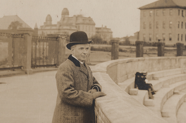 John D. Archbold, Syracuse University benefactor, shown at Archbold Stadium, circa 1909-1916. Note the Hall of Languages in the background.