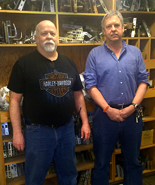 Locksmiths Mike Kennedy (left) and Matt Kellar (right) were honored Monday for their combined 60 years of service to the University.