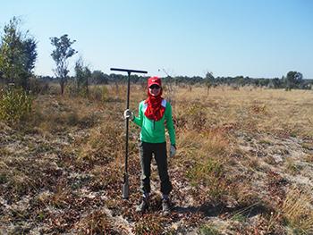 Kristin Weeks doing field work, soil coring