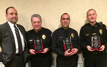 Chief John Sardino, left, honored Det. Ed Weber, Det. Mike Toia and Sgt. Timothy Salanger.
