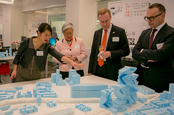 Chancellor Kent Syverud, second from right, and his wife, Dr. Ruth Chen, second from left, look over the work of architecture students in the studios at the Syracuse University Fisher Center in New York City, as part of Tuesday's celebration. From left are Angela Co, coordinator of Syracuse Architecture New York City; Dr. Chen; Chancellor Syverud; and School of Architecture Dean Michael Speaks.