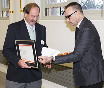 Patrick Ahearn, left, receives an alumni award last fall from Dean Michael Speaks.