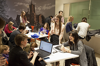 Students from the various immersion programs in New York City gather to work and relax in a lounge area in the new Syracuse University Fisher Center.