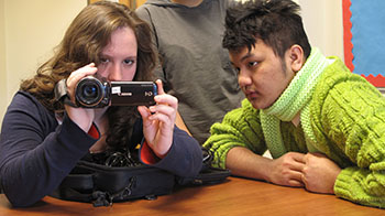 SU sophomore Michelle Golonka explains how to operate a video camera to Fowler senior Jacob Ngawi during a training session of the SU/Fowler Film Project held March 28.