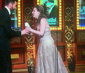 Jessie Mueller onstage at the Tony Awards with host Hugh Jackman.
