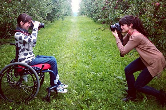 Taylor Baucom and Gena Buza, who share a love of photography, snap a shot of each other at the Beak and Skiff Apple Orchard in LaFayette, N.Y., last fall. (Photo was taken by Sue Buza)