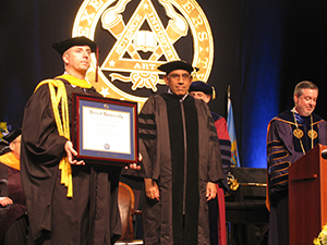 Pramod Varshney, center, receives an honorary degree from Drexel University.