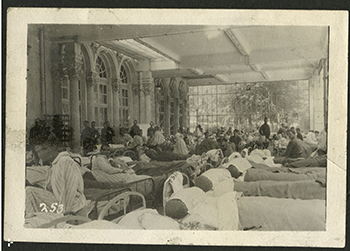 Patients convalesce inside U.S. Army Base Hospital #31, which had been transformed from a casino and hotel in Contrexeville, France, during WWI. Syracuse University medical school graduate Dr. Edward S. Van Duyn (1897) served at the hospital during his time as a military surgeon. From the Edward S. Van Duyn World War I Collection, courtesy of the Special Collections Research Center at Syracuse University Libraries